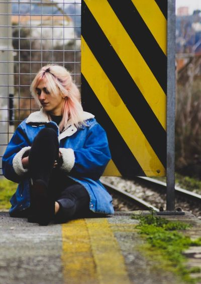 Her Sitting Distraught  Depression - Sadness City Train Station Pink Color Pink Jeans Shotting  Full Length One Person Young Adult Girl