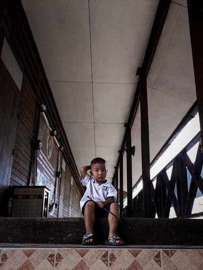 Full length portrait of boy sitting