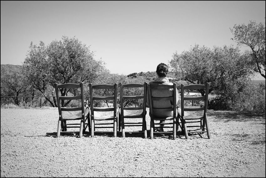 le passage du temps Black & White Composition EyeEm Best Shots EyeEm Nature Lover EyeEm Gallery Fujifilm X100T Black And White Blackandwhite Blackandwhite Photography Bw_collection Bw_lover Chairs Fujifilm_xseries Landscape One Person Outdoors Real People Rear View Relaxation Rural Landscape Rural Scene