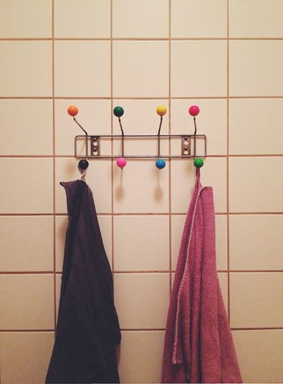 Towels hanging from hooks on wall