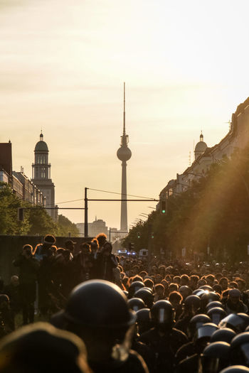 BERLIN, GERMANY - May 1, 2019: several thousand left-winged protesters are marching through Berlin-Friedrichshein to demonstrate against gentrification, unaffordable housing due to rising rents and for a more socialist economy and politics. Berlin Friedrichshain Protest Protesters Germany Demonstration Politics And Government Labor Social Issues Equality Punk Social Architecture Crowd Built Structure Building Exterior City Large Group Of People Group Of People Tourism Travel Destinations Travel Sky Tower Real People Building Tall - High Men Sunset Nature Outdoors Spire
