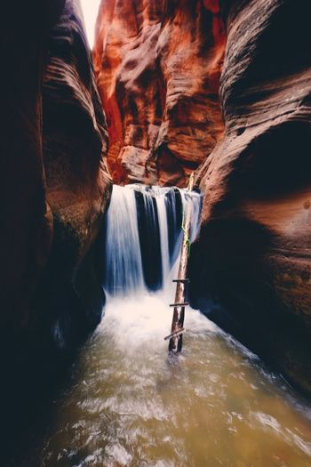 Adventure Beauty In Nature Cave Cliff Day Flowing Water Geology Long Exposure Motion Nature No People Outdoors Physical Geography Power In Nature River Rock - Object Rock Formation Scenics Tourism Travel Travel Destinations Vacations Water Waterfall Waterfront