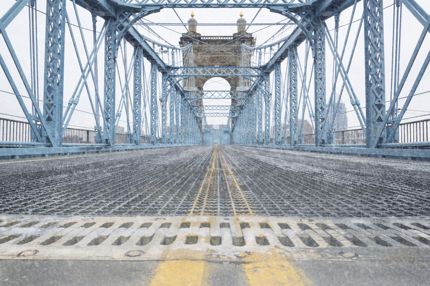 Cincinnati Ohio Closed Bridge Ice John A. Roebling Suspension Bridge Low Angle View Abandoned Brick Bridge - Man Made Structure Day Double Yellow Lines Icy No Cars In This Picture No People No Traffic Outdoors Snowing Steel Suspension Bridge Suspension Bridge, Transportation Travel