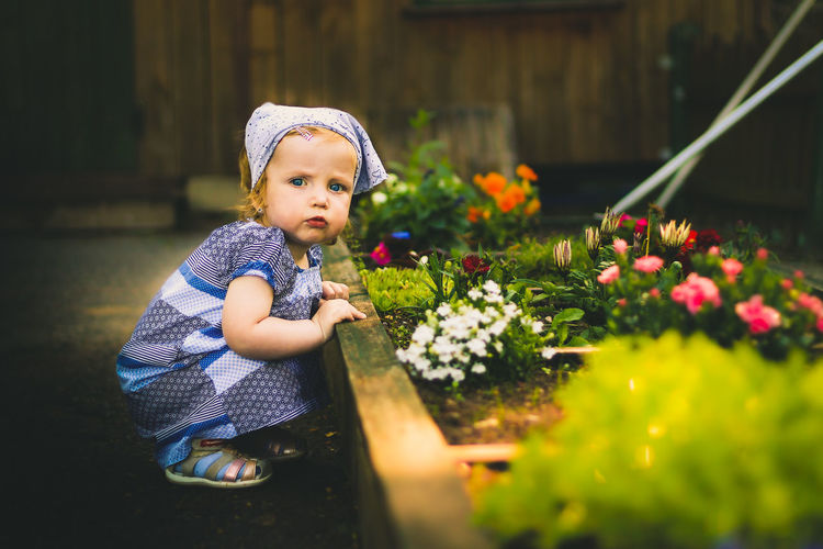 Cute baby girl in back yard