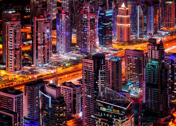 Dubai marina skyline during night. Colorful neon lightens multiple tallest skyscrapers of the world. Amazing detail of middle east city. Dubai marina, United Arab Emirates. Dubai Marina Traffic United Arab Emirates Architecture Building Building Exterior Built Structure City City Life Cityscape Crowded Detail High Angle View Illuminated Landscape Modern Night Nightlife Office Building Exterior Residential District Skyscraper Tall - High Tower Travel Destinations