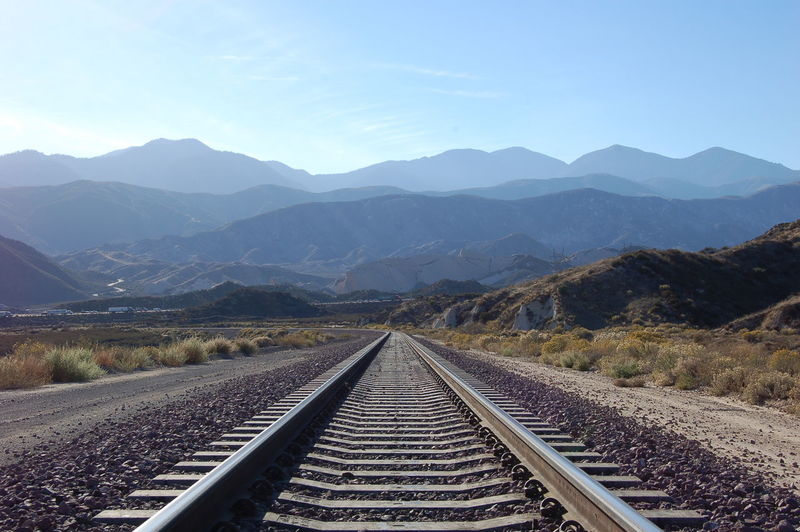 Looking east down track towards the San Gabriel Mountains from Cajon Pass. Beauty In Nature Cajon Pass Clear Sky Day Landscape Mountain Mountain Range Nature No People Outdoors Rail Transportation Railroad Track Scenics Sky The Way Forward Tranquil Scene Transportation