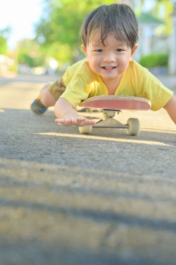 Portrait of cute boy playing outdoors