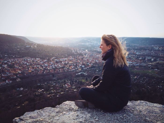 Woman Looking Jena City Cityscapes Cityscape City Life Citylife City View  Discover Your City Thuringia Germany View From Above Mountain Travel One One Person Lifestyle People Sunset IPhoneography The Portraitist - 2016 EyeEm Awards Day Sitting Rocks