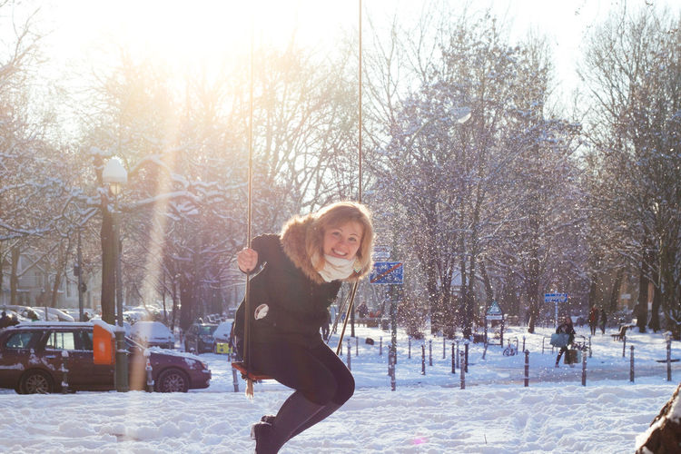 Beautiful Woman Beauty Berlin Kreuzberg Cheerful City Cold Temperature First Snow Fun Happiness Leisure Activity One Person One Woman Only Only Women Outdoors Portrait Smiling Snow Sunshine Swing Swinging Tree Vitality Warm Clothing Winter Winterwonderland