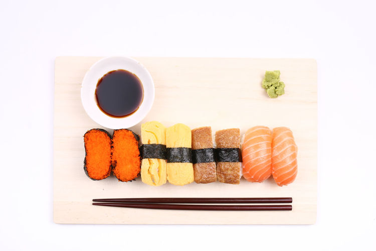 Assorted sushi mix on white background Sushi Food And Drink Rice Food Japanese Food Freshness Japan AssoRted Variety Fresh Seafood Meal Cuisine Chopsticks White Background Isolated