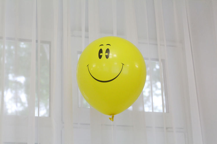Balloon by window at home