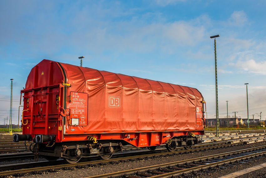 DB DB Bahn DB Cargo Cargo Container Day Freight Train Freight Transportation Land Vehicle Locomotive Mode Of Transport No People Outdoors Public Transportation Rail Transportation Railroad Track Red Sky Train - Vehicle Transportation