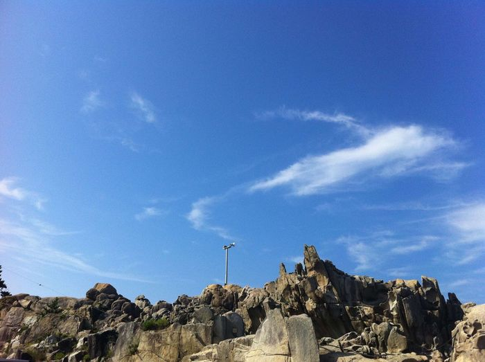 Rock - Object Rock Formation Sky Nature Geology Day Blue Physical Geography Cloud - Sky Tranquility Outdoors No People Low Angle View Beauty In Nature Scenics