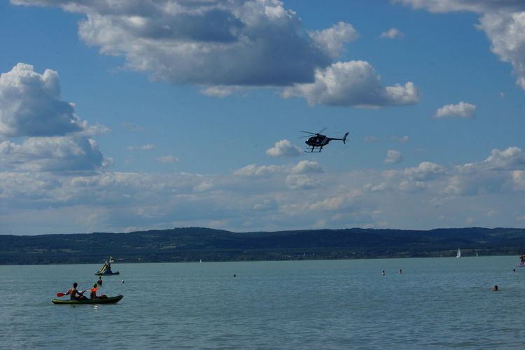 Transportation Flying Nautical Vessel Blue People Day Outdoors Sky Adults Only Teamwork Airshow Adult Sommergefühle Helicopter View  Balatonföldvár EyeEm Selects Airplane No People Water Only Men Aerobatics