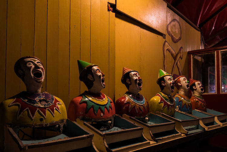 Clown Statues In Amusement Park At Night