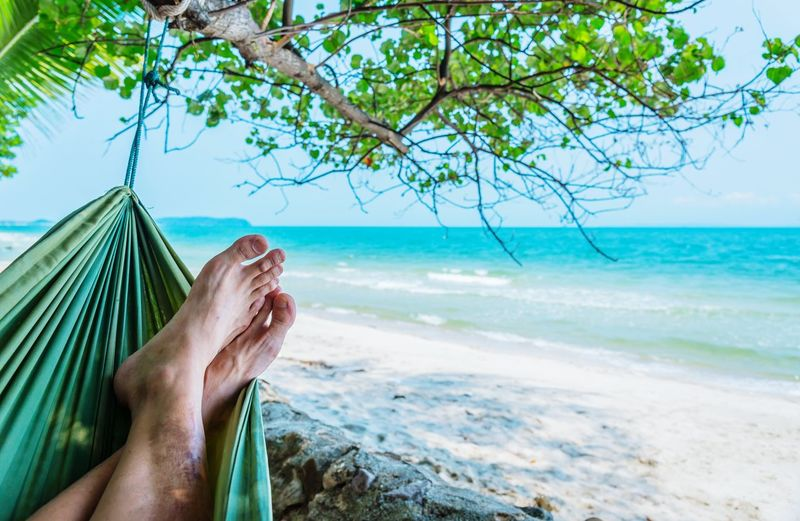Relaxing time on Thailand ocean Sea Water Vacations Relaxation Barefoot Human Foot Travel Destinations Sky Outdoors Clear Sky Travel Thailand Tree Ocean Relax