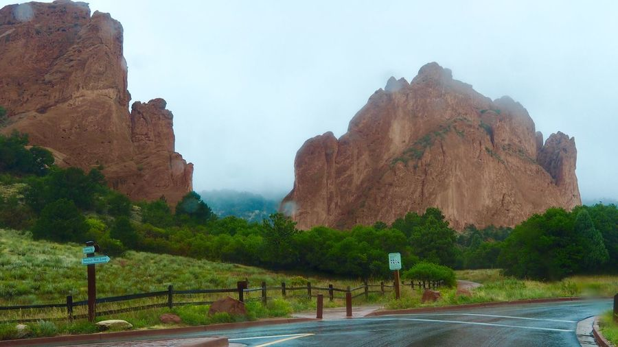 Garden of the Gods Sign Road Mountain Beauty In Nature Scenics - Nature Tranquil Scene Direction Sky Nature Rock Transportation Tranquility The Way Forward No People Rock - Object Rock Formation Day Plant Tree