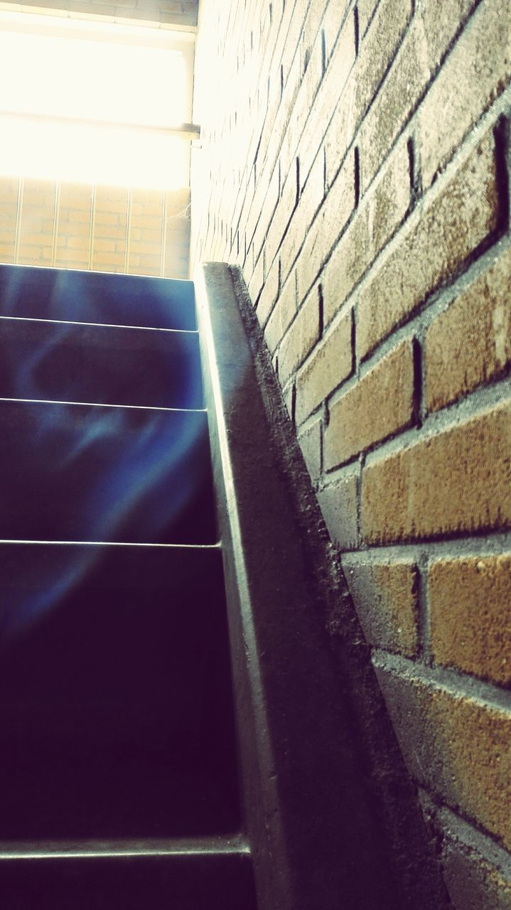 wall - building feature, brick wall, steps, architecture, indoors, built structure, steps and staircases, staircase, no people, low angle view, day, illuminated, close-up