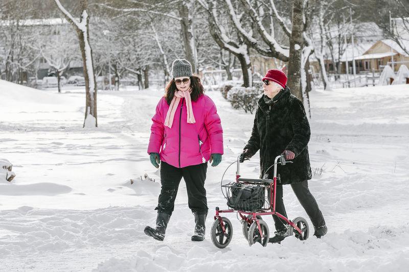 Women on field during winter
