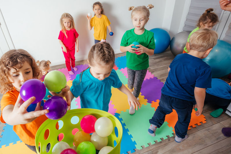 Group of people playing balloons