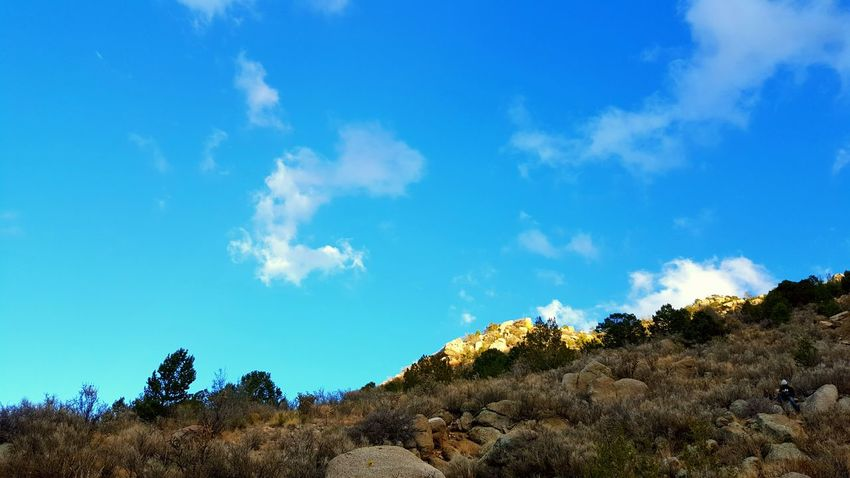 Clouds And Sky Sky Cloud - Sky Dirt Sun Day Rocks Sunny Day Scenics Nature Outdoors Hiking, Mountains, Adventure Sandia Mountain Dry Landscape Adventure Mountain Travel Mountain Range Sunny Rock Activity No People