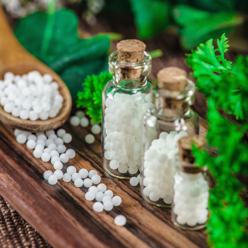 Close-up of homeopathic medicines on table