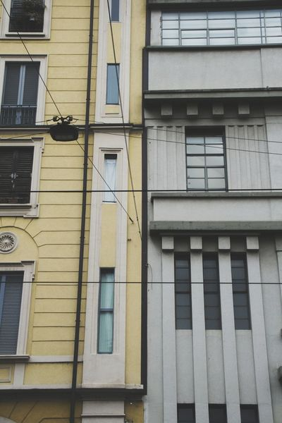 Milan Architecture Building Exterior Window Built Structure Outdoors Day Low Angle View Apartment EyeEm Photography EyeEmNewHere Asimmetry Asimmetric City Center Milan Italy Architecture Photo Yellow Gray Colors Cold