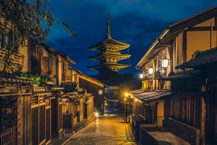 Hokan-ji temple, kyoto, japan view from illuminated street at night.