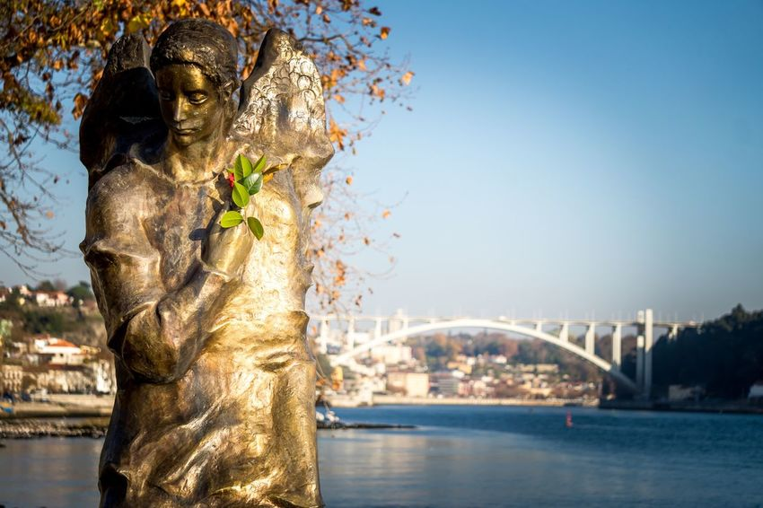 Statue Sculpture Female Likeness Human Representation Gold Gold Colored Travel Destinations Outdoors Arts Culture And Entertainment Water Clear Sky Architecture No People Sky City Day