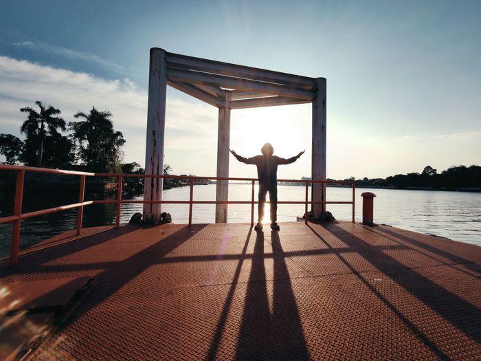 Full length of man standing on pier