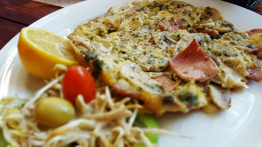 High Angle View Of Omelet Served In Plate