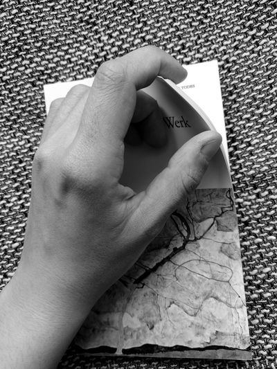 Close-up of hand holding paper