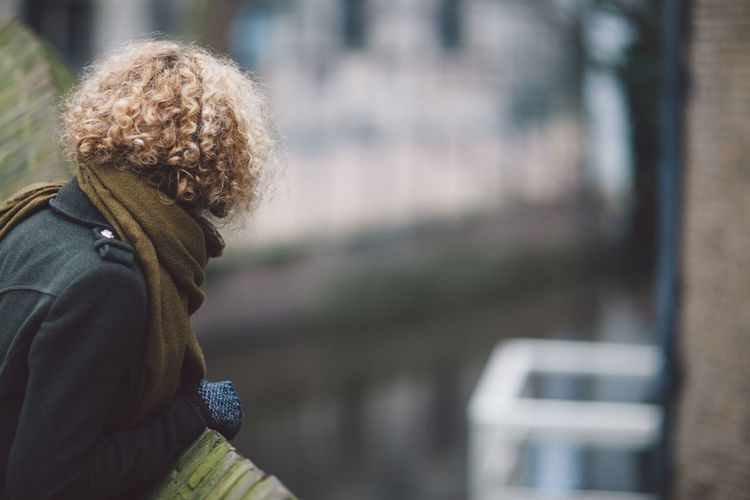 Side View Of Woman Wearing Warm Clothing While Looking Away In City