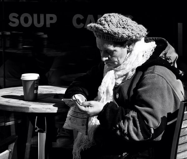 Street photograghy, liked the lived in look of this woman outside a coffee shop in London