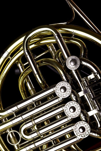 Music Instrument French Horn, French horn Isolated on black Music Musical Instrument Arts Culture And Entertainment Metal Brass Instrument  Brass Studio Shot Black Background Close-up Indoors  Wind Instrument Musical Equipment No People Gold Colored Still Life Shiny Single Object Trumpet Equipment Cut Out