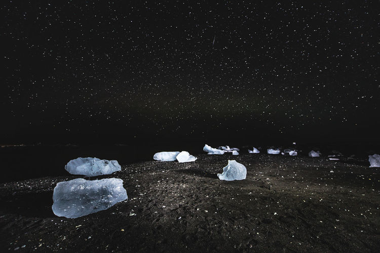Solid Rock Stone - Object Rock - Object Nature Night No People Water Land Beauty In Nature Stone Tranquility Cold Temperature Sea Tranquil Scene Beach Scenics - Nature Outdoors Winter Pebble Iceland