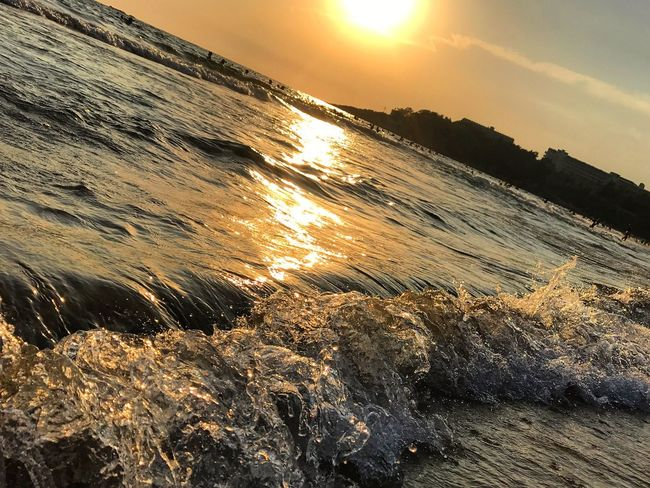 Perspectives On Nature Sunset Nature Sea Beauty In Nature Sun Water Sky Scenics Beach No People Outdoors Sunlight Tranquility Wave Close-up Day