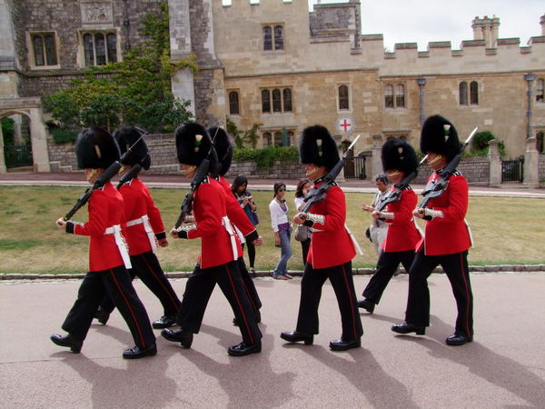 Guards at Windsor Castle Buildings Castle Composition Day Full Frame Full Length GB Guards Hats Incidental People Large Group Of People Lifestyles Marching Marching!  Men Outdoor Photography Red Coats Rifle Shaadows Side View Soldiers Togetherness Tourist Attraction  Uk Windsor
