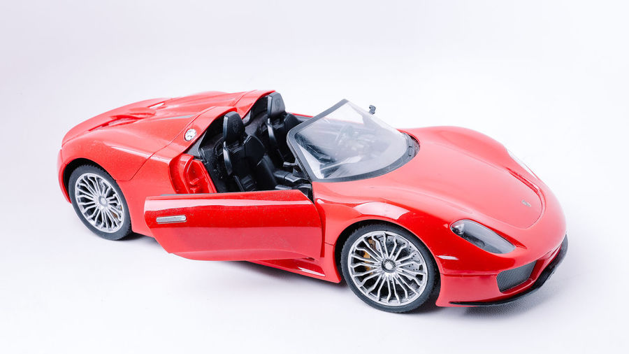 Red Ferrari Replica toy Car Mode Of Transportation Motor Vehicle Transportation Red Studio Shot White Background Land Vehicle Indoors  Sports Car Wealth Luxury Cut Out No People Choice Toy Convertible Modern Wheel Nature