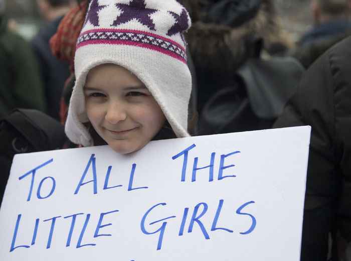 Child holding sign. Women's Solidarity March in Toronto, Canada. January 21, 2017 marked the history of the capital city of Ontario with one of the largest protest march gathering more than 60,000 people. Women were claiming more social justice and protesting many of Donald Trump stances. Anti-trump Canada Canadian Demanding  Democracy Freedom Girls Headshot Leftist March Movement One Person Ontario Outdoors People Power Revolution Signs Social Justice Symbols Text Toronto Toronto Canada Women's March Women's Solidarity March