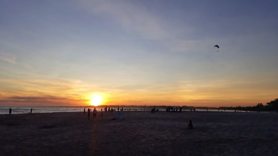 Beach Sunset Sand Sky Sea Incidental People Flying Nature Horizon Over Water Silhouette Sun Beauty In Nature Large Group Of People Outdoors Water People Volleyball - Sport Scenics Summer Vacations