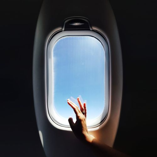 Window Airplane Looking Through Window Indoors  One Person People Flying Only Women Human Hand Human Body Part Day Close-up Adult Sky Breathing Space EyeEmNewHere EyeEm Gallery EyeEm Best Shots EyeEmBestPics EyeEm Selects EyeEm Travel Destinations The Week On EyeEm Done That. EyeEm Ready   My Best Photo