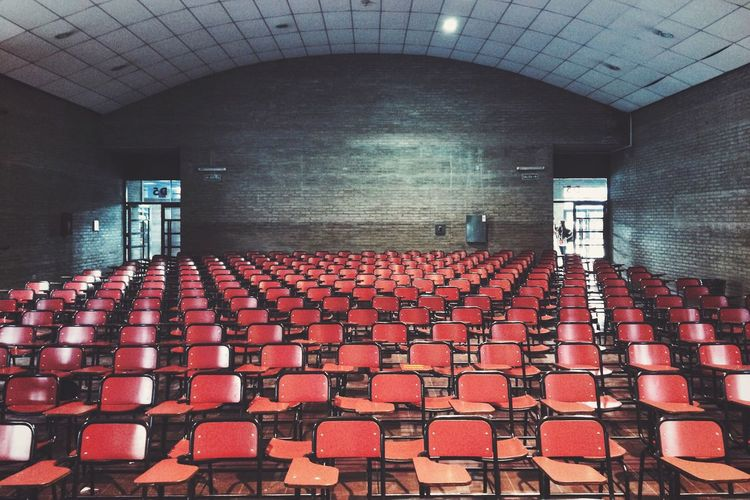 Rows of empty seats in lecture hall