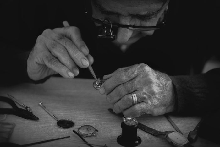 The watchmaker Hands At Work Loupe Occupation Skill  Tools Watch Watchmaker Work Tool People And Places Blackandwhite Photography Blackandwhite Monochrome Monochrome Photography