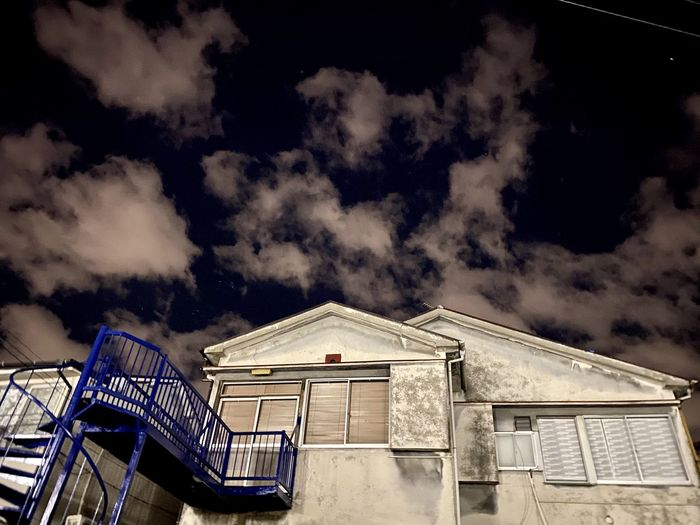Low angle view of abandoned building against sky at night