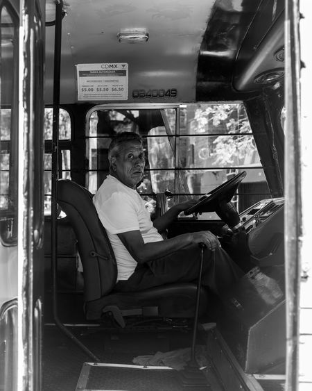 Watch the behind-the-scenes video of how this photo, and many more, was captured here: https://www.youtube.com/watch?v=zGz2vO_8L_Y Black & White EyeEm Best Shots EyeEm Gallery Mexico City WeekOnEyeEm Black And White Blackandwhite Photography Bus Fuji Fujifilm Men Mexicolors Mode Of Transportation One Person Real People Seat Sitting Street Photo Street Photography Streetphoto_bw Streetphotography Transportation Vehicle Interior Week On Eyeem X100f