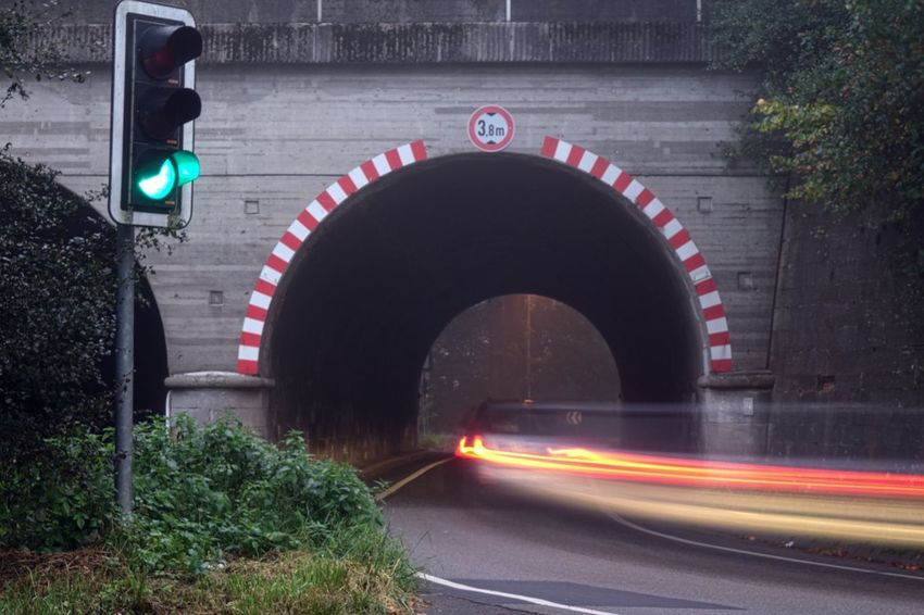 Ampel Arch Architecture Bridge - Man Made Structure Building Exterior Built Structure City Connection Illuminated Land Vehicle Long Exposure Motion Night No People Outdoors Road Road Sign Speed Transportation Tunnel Tunnel View Verkehrszeichen