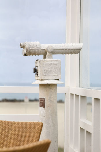 Side View Of Telescope Against The Sea
