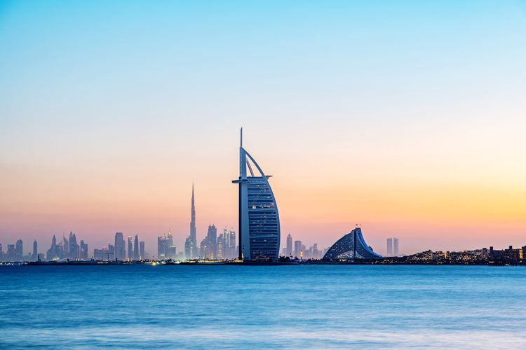 Skyline of Dubai with the iconic Burj Al Arab at sunset, Dubai, United Arab Emirates 🇦🇪 Wanderlust Architecture Sky Building Exterior Built Structure Building Skyscraper Urban Skyline City Water Landscape Travel Destinations Sunset Cityscape Travel Tower Tourism No People
