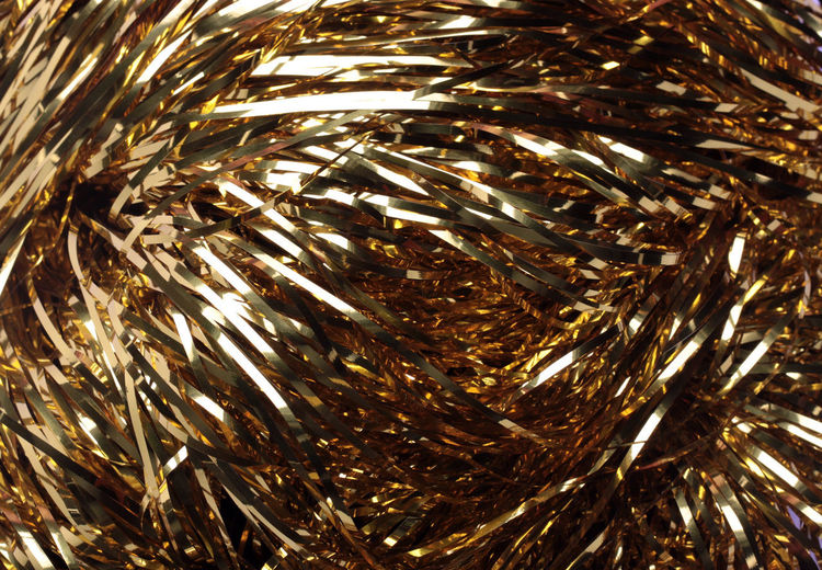 Christmas background of Golden tinsel Be. Ready. Christmas Background Of Golden Tinsel Background Backgrounds Canon Celebration Christmas Close-up Full Frame Gold Gold Colored New Year Holiday\ Christmas Tree Toys Balls Gold Star Tinsel Night No People Outdoors Shiny